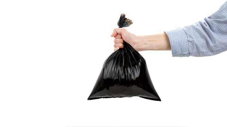 man holding garbage