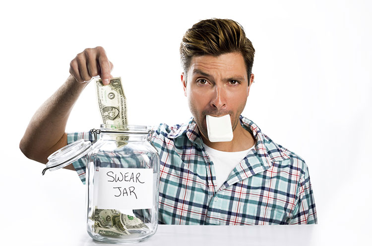 man paying swear jar