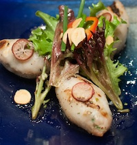 Sausage-stuffed Squid with Almond, Fresno Chile and Finger Lime Salad