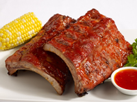 Sweet and Spicy Glazed Baby Back Ribs Featuring Heinz® Sweet and Spicy Garlic Chili Sauce