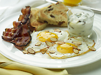Fried Eggs With Toasted Almonds, Raisin Toast & Maple Butter