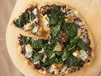 Pizza with Black Olive Tapenade, Roasted Cipollini Onions, Grilled Tuscan Kale and Aged Goat Cheese