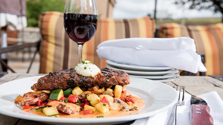 steak potatoes vegetables on plate