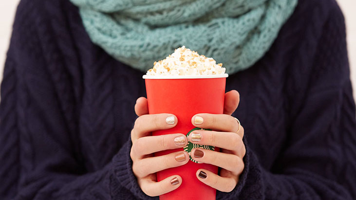 woman holding holiday starbucks drink