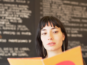 woman reading menu menu information transparency point of origin
