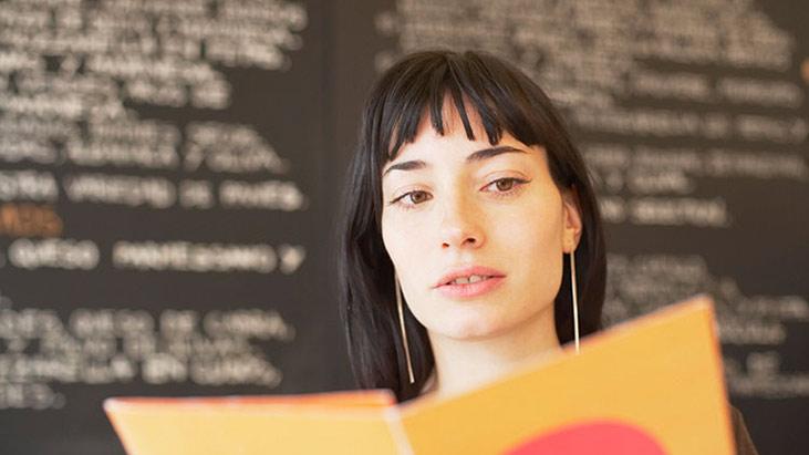 woman reading menu